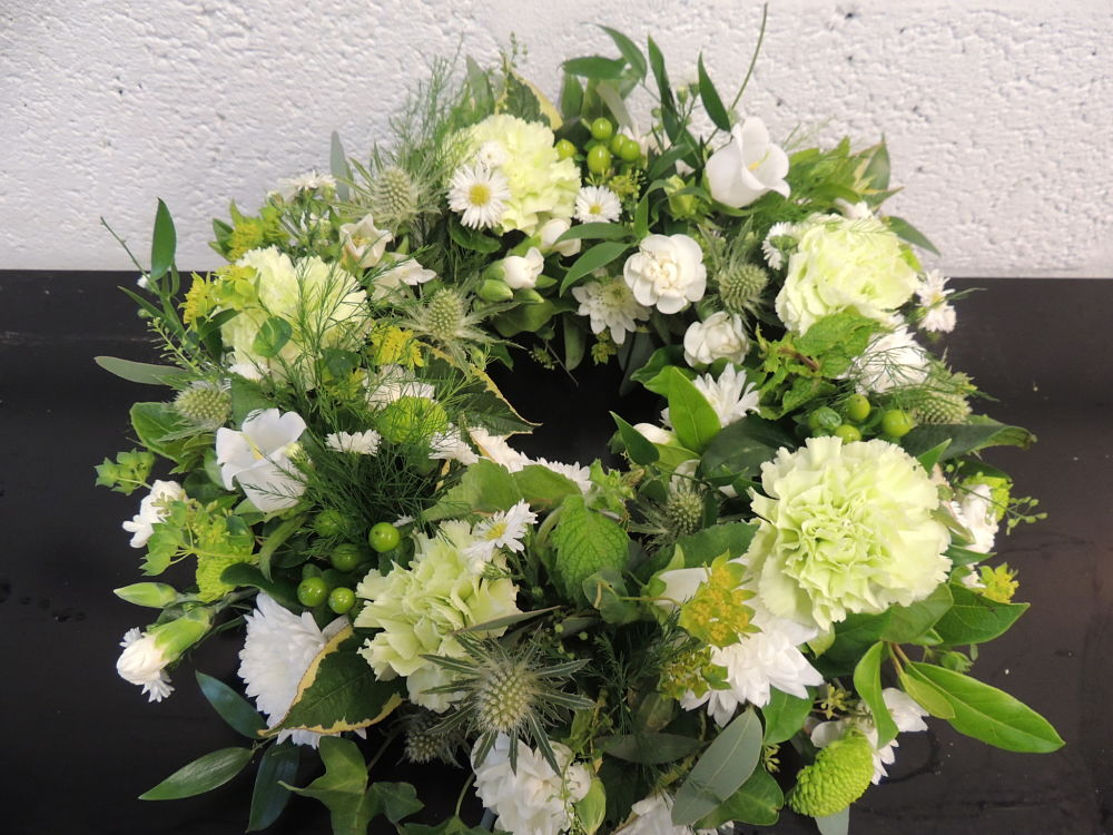 white and green funeral tribute